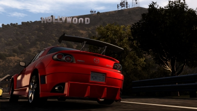 A Mazda RX8 in front of the Hollywood sign